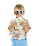 Young cute boy holding lot of cash, american Royalty Free Stock Photos