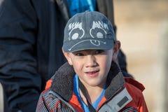 Cute boy wearing an unusual ball cap stock photography