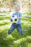 Young Cute Boy Playing with Soccer Ball in Park Royalty Free Stock Photos
