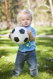 Young Cute Boy Playing with Soccer Ball in Park Stock Photography
