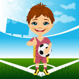 Young cute boy with soccer ball standing in stadium Stock Photos