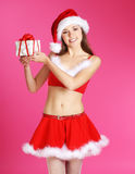 A young and cute brunette in a Christmas dress Stock Image
