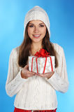 A young and cute brunette with a Christmas present Stock Photos