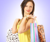 A young and cute brunette doing shopping Stock Photos