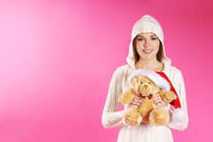 A young and cute brunette girl in a hoodie Stock Photography