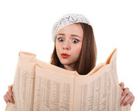 Young cute brunette girl with newspaper Stock Photos