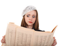 Young cute brunette girl and newspaper Stock Photos