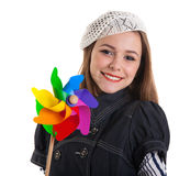 Young cute brunette girl with wind turbine toy Stock Images