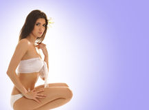 A young and cute brunette in white lingerie Stock Photo