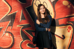 Young cute brunette woman graffiti background outdoors Stock Images