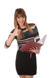 Young cute business woman with a book Royalty Free Stock Images