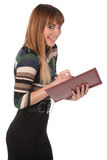 Young cute business woman with a book in her hands Stock Photo