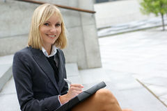 A young and cute businesswoman in formal clothes Royalty Free Stock Photo