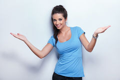Young cute casual woman wlecoming Royalty Free Stock Image