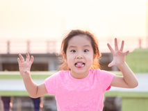 Young cute cheeky girl Royalty Free Stock Photo