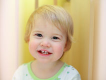 Young cute child in crib. Smiling Royalty Free Stock Photography