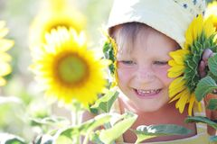 Young cute child with sunflower Royalty Free Stock Photo