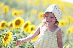 Young cute child with sunflower Stock Photos