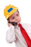 Young cute contractor boy on cell Stock Photo