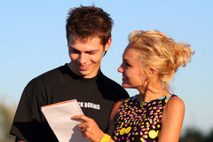Young cute couple boy and girl. Young cute couple dialogue and write explanations royalty free stock photo