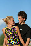 Young cute couple boy and girl. Young cute couple meeting after a long period of time royalty free stock image