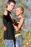 Young cute couple boy and girl. Young cute couple meeting in park royalty free stock photos