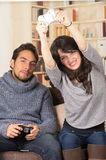 Young cute couple playing video games Royalty Free Stock Photography
