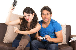 Young cute couple playing video games. Young cute happy couple playing video games isolated on white Royalty Free Stock Photography