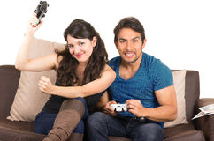 Young cute couple playing video games. Young cute happy couple playing video games isolated on white Stock Photos