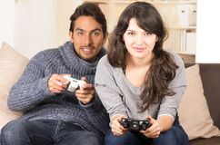 Young cute couple playing video games Stock Photo