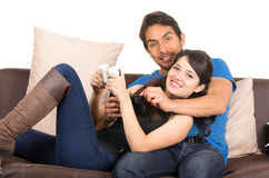 Young cute couple playing video games. Young cute loving couple playing video games isolated on white Royalty Free Stock Image