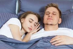 Young cute couple sleeping together in bed. In the morning royalty free stock photos