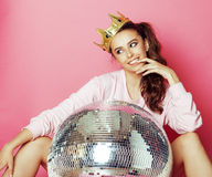 Young cute disco girl like doll on pink background Stock Image
