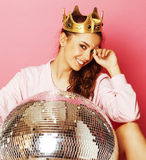 Young cute disco girl like doll on pink background Royalty Free Stock Image