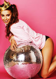 Young cute disco girl on pink background with disco ball and cro Royalty Free Stock Photos