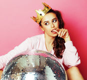 Young cute disco girl on pink background with disco ball and cro Stock Images