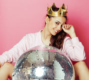 Young cute disco girl on pink background with disco ball and crown Royalty Free Stock Image