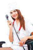 Young cute doctor takes calls Stock Photos