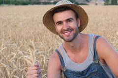 Young cute farmer boy in the fields Stock Photos