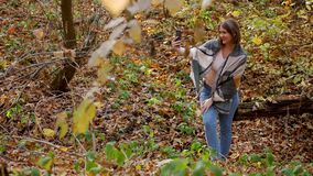 Young cute female enjoy autumnal nature