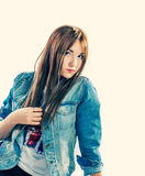 Young cute female in jeans Stock Images