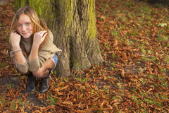 Young cute girl in autumn park. Nature. Young cute girl in autumn park Stock Photo