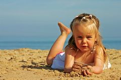 Young cute girl on beach Stock Images