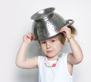 Young cute girl cooking Royalty Free Stock Photos