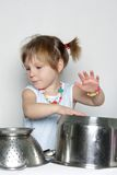 Young cute girl cooking Stock Image