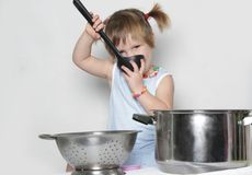 Young cute girl cooking Stock Photography