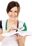 Young cute girl with a dictionary Stock Photography