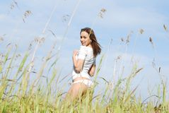Young cute girl in a field Royalty Free Stock Photography