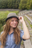 Young cute girl in the hat, outdoors outside the city. Walk. Royalty Free Stock Photography