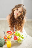 Young cute girl having breakfast Stock Images